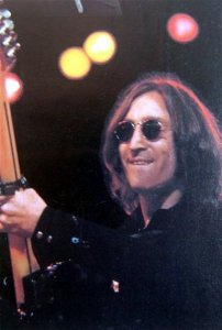 In the middle of John Lennon's work on his 1974 album Walls And Bridges, he encountered a certain man named Elton John, who was (at the time) the hottest-selling recording artist of the decade. The two got along swimmingly, and Lennon invited Elton to help him create his latest work. With Elton John as a catalyst, the album (and associated singles) began to take a different shape. Upon hearing the catchy pop song Whatever Gets You Through the Night (on which he also sings), Elton told Lennon that the song would hit #1. It did. The song sounds more like an Elton John number than a John Lennon single, but no matter. People went right out and bought it! The collaboration also led to Elton John covering The Beatles' Lucy in the Sky with Diamonds and Lennon's One Day at a Time. In what would be Lennon's last live performance, the pair performed Whatever Gets You Through The Night and Lucy In The Sky With Diamonds along with the Beatles classic I Saw Her Standing There at Madison Square Garden on Thanksgiving night, November 28, 1974.